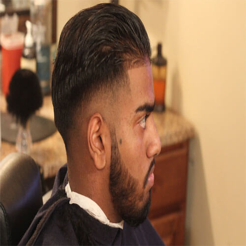 High Taper Fade with Long Slicked Back Hair